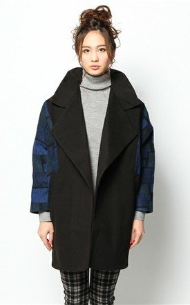 Black coat with blue brick sleeves by Liquorish Product photo