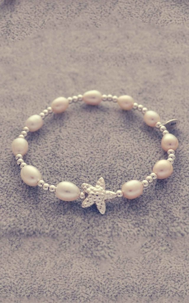Sterling silver and pearl bracelet with star fish charm by Alyssa Jewellery Design