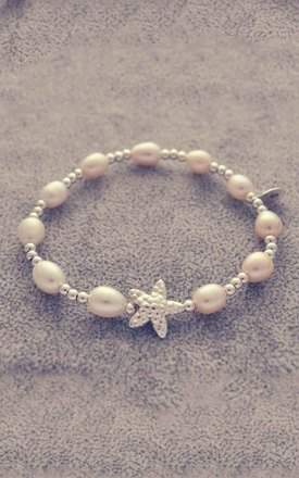 Sterling silver and pearl bracelet with star fish charm by Alyssa Jewellery Design Product photo