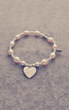 Sterling silver and pearl hammered heart bracelet by Alyssa Jewellery Design Product photo
