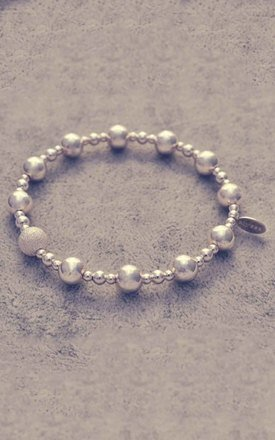 Sterling silver mixed ball bracelet with frosted ball charm by Alyssa Jewellery Design Product photo