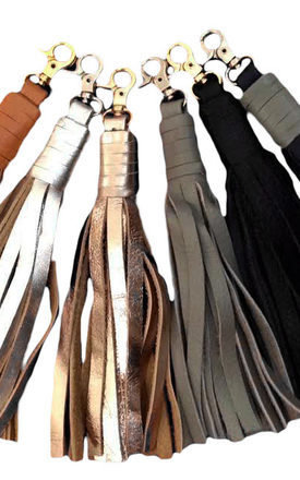 Leather clip-on tassel in tan by Driftwood Bags Product photo