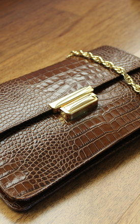 Croco print flap closure by THE CODE HANDBAGS Product photo