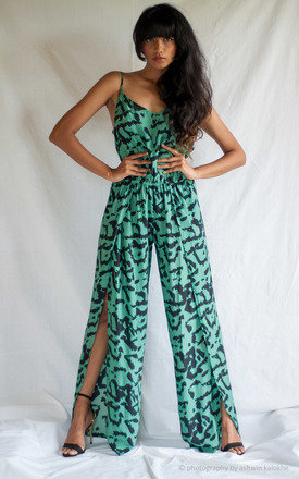 Cross back palazzo petal jumpsuit in leopard satin silk by TIA Product photo