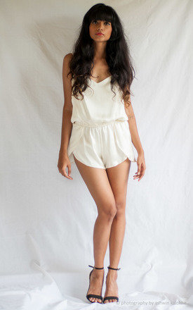 Cross back petal short jumpsuit by TIA Product photo