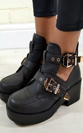 Molly chunky heel double buckle ankle biker boots in black by NAOMISHU Product photo