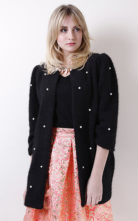Fluffy black coat with pearls by Liquorish Product photo