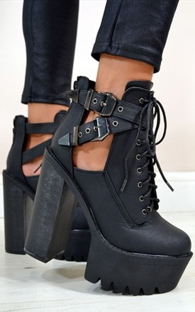 Ruby cut out buckle ankle boots by NAOMISHU Product photo