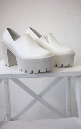White platform mules by Cats got the Cream Product photo