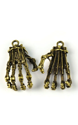 New antique skull hand charm by Emi Jewellery Product photo