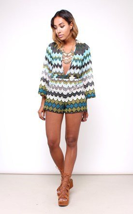 70s inspired bell sleeve deep v playsuit by House of Jam Product photo
