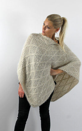 Ivory criss cross knit poncho by Scarlett Black London Product photo