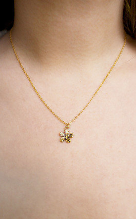 Tiny gold flower necklace by Terra Dea