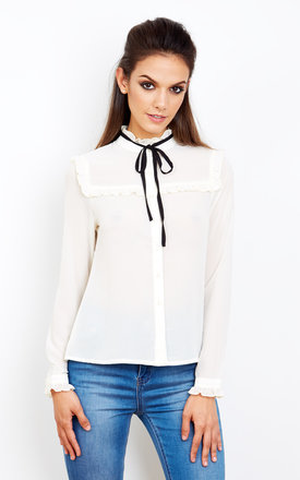 Cream frill blouse with black neck tie detail by Glamorous