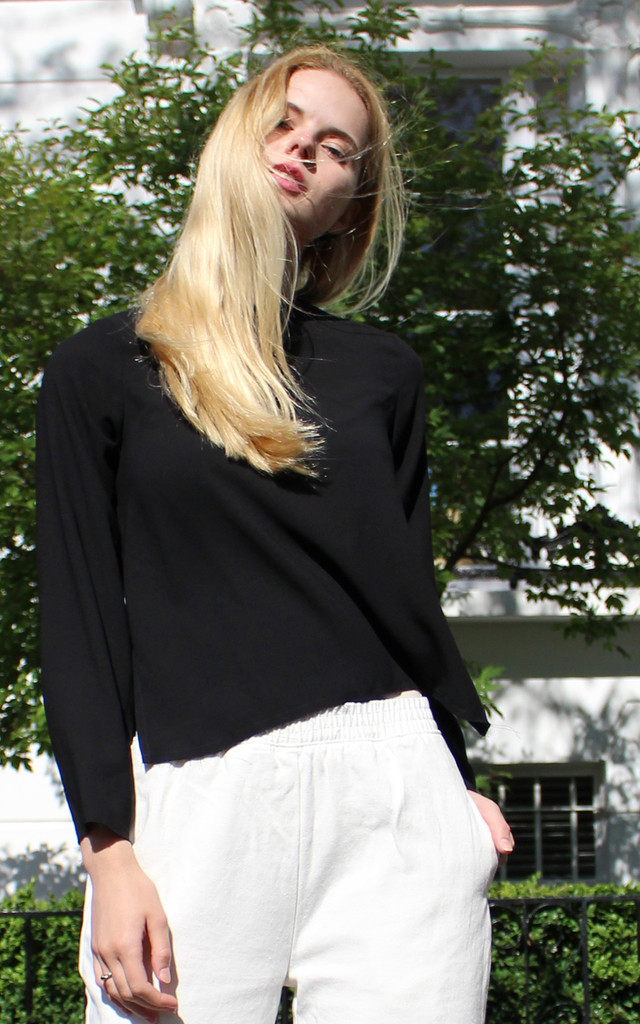 Black raw edge loose fit top by Daze