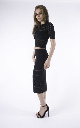 Lady in Black Skirt and Top Co-Ord by Girl Outlaw