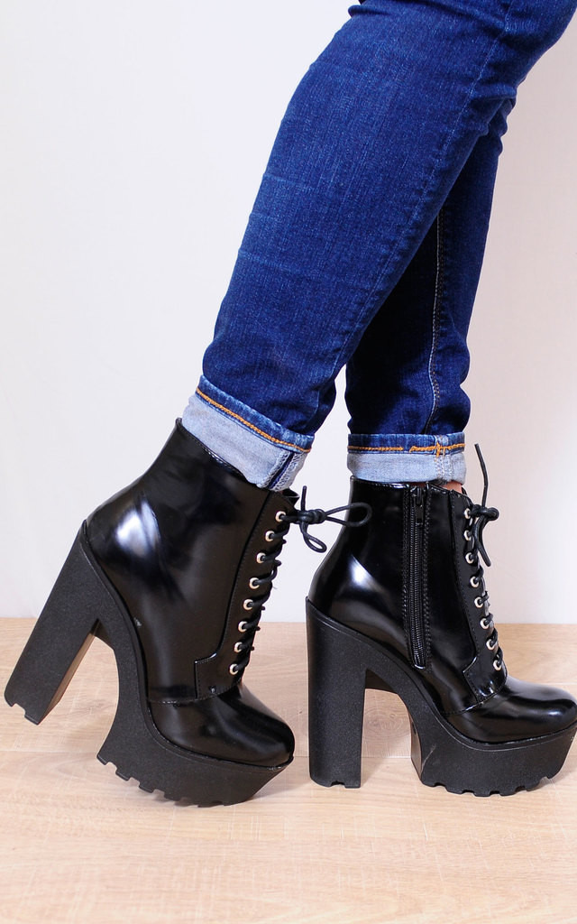 Black Faux Leather Cleated Platforms Ankle Boots by Shoe Closet