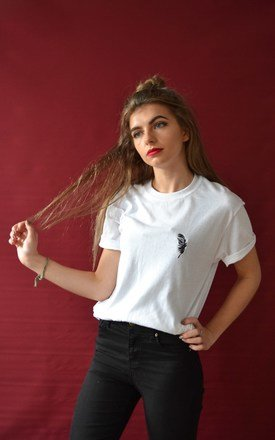Embroidered Feather on white tee by Emma Warren