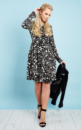 Long Sleeve Lace Up Dress With Black Cut Out Print by Glamorous Product photo