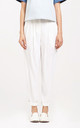 Peg leg trousers with d-ring belt in white by Paisie