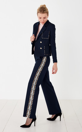Narmada Trousers with Leopard print details by No Ordinary Suit