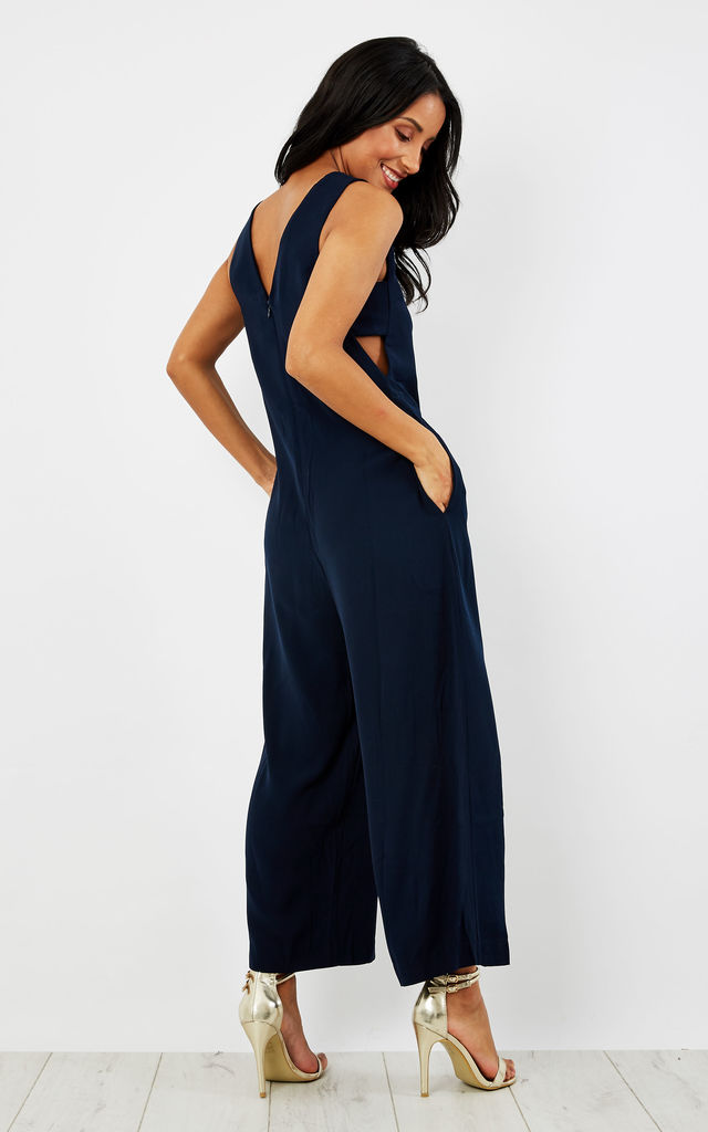 Cropped jumpsuit with side cut outs by Paisie