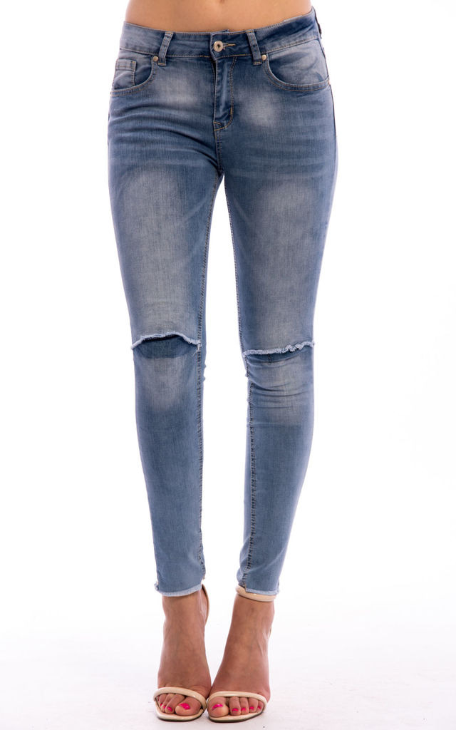 Knee Ripped Mid Rise Denim Jeans in BLUE by Npire London