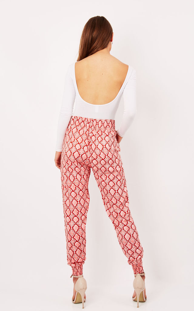 Pink Snake Print Cuffed Jogger Trousers by Ruby Rocks
