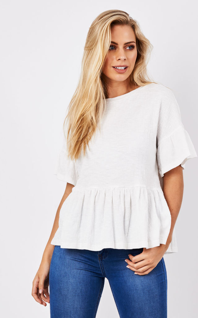 Jersey top with ruffled sleeves and hem by Paisie