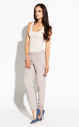 Beige Joggers With Decorative Gold Locks by Dursi