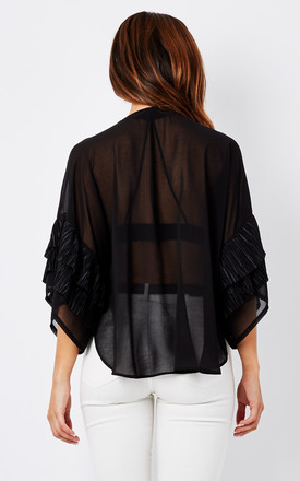 Black Top With Front Tie And Ruffle Sleeves by Minkie