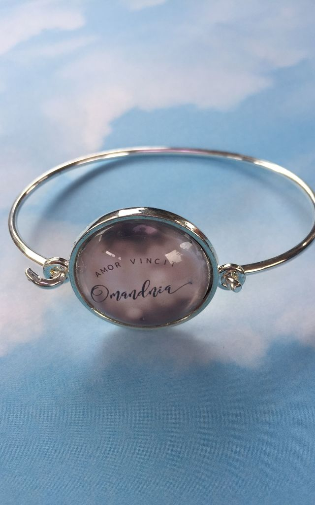 """Love Conquers All"" slogan statement bangle bracelet in silver and pink by Soul Warriors"