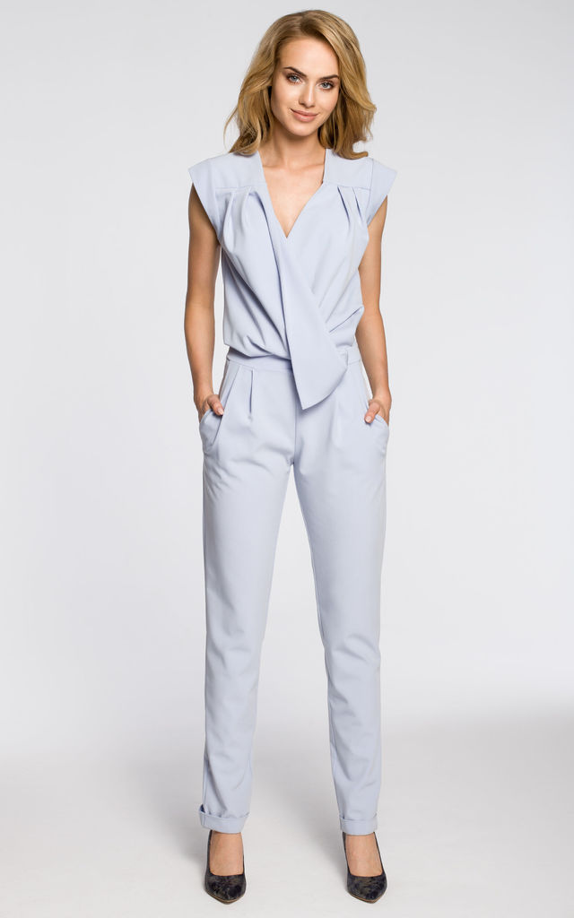 Light blue sleeveless, draped jumpsuit with a wrap and side pockets by MOE