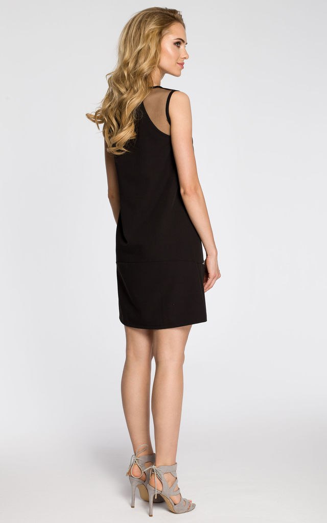 Black plain sleveless dress with tulle finishing and front rib finished pockets by MOE