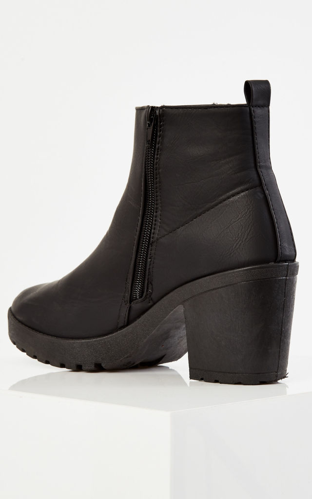 Black PU ankle zip boots by Truffle Collection
