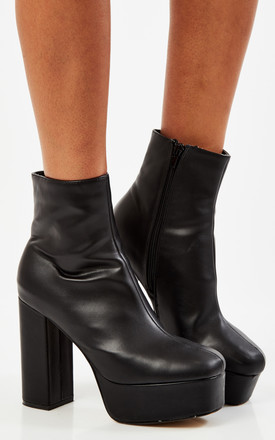 Black Pu Platform Boots by Truffle Collection Product photo