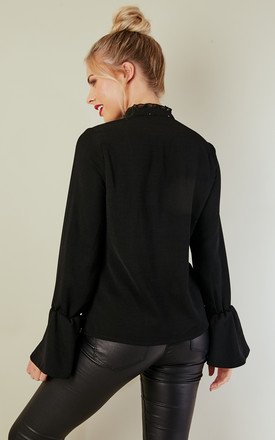 Black frill sleeve shirt by Bella and Blue