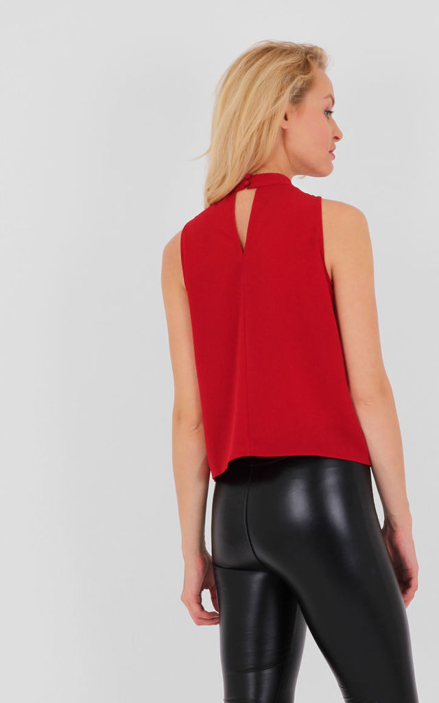 Red Sleeveless High Neck Swing Top by MISSTRUTH