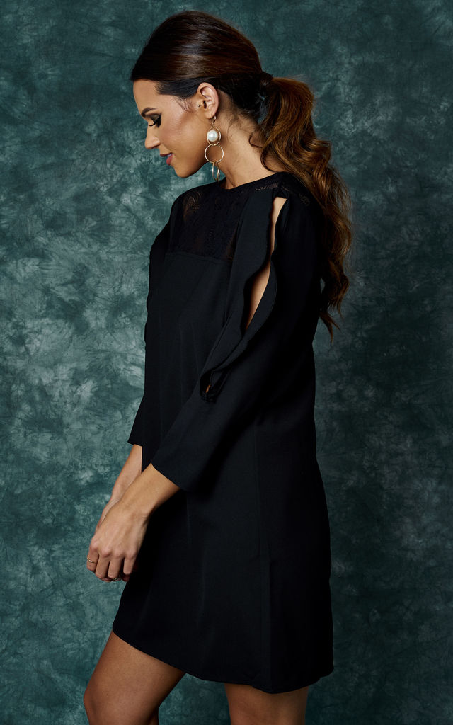 BLACK WOVEN DRESS WITH NECK LACE DETAIL AND RUFFLE SLEEVES by The Vanity Room