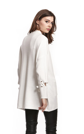 Cream Long Turtleneck Jumper With Front Pockets And Lacing Detail On Sleeves by Liquorish
