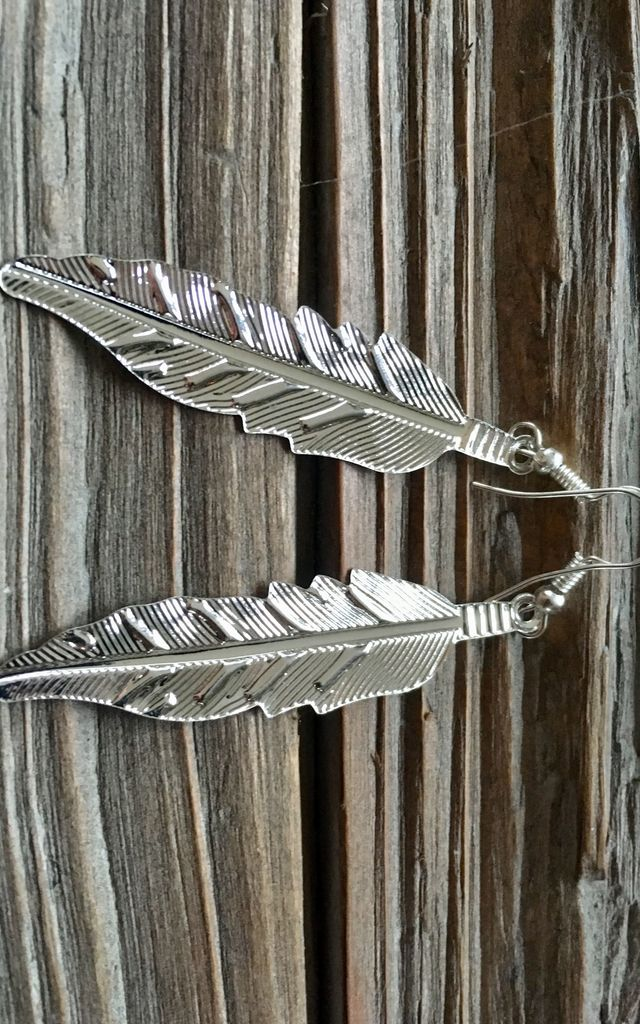 Silver feather earrings by Lovelock jewels