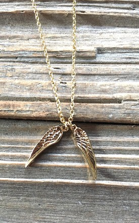 Gold angel wings necklace by Lovelock jewels