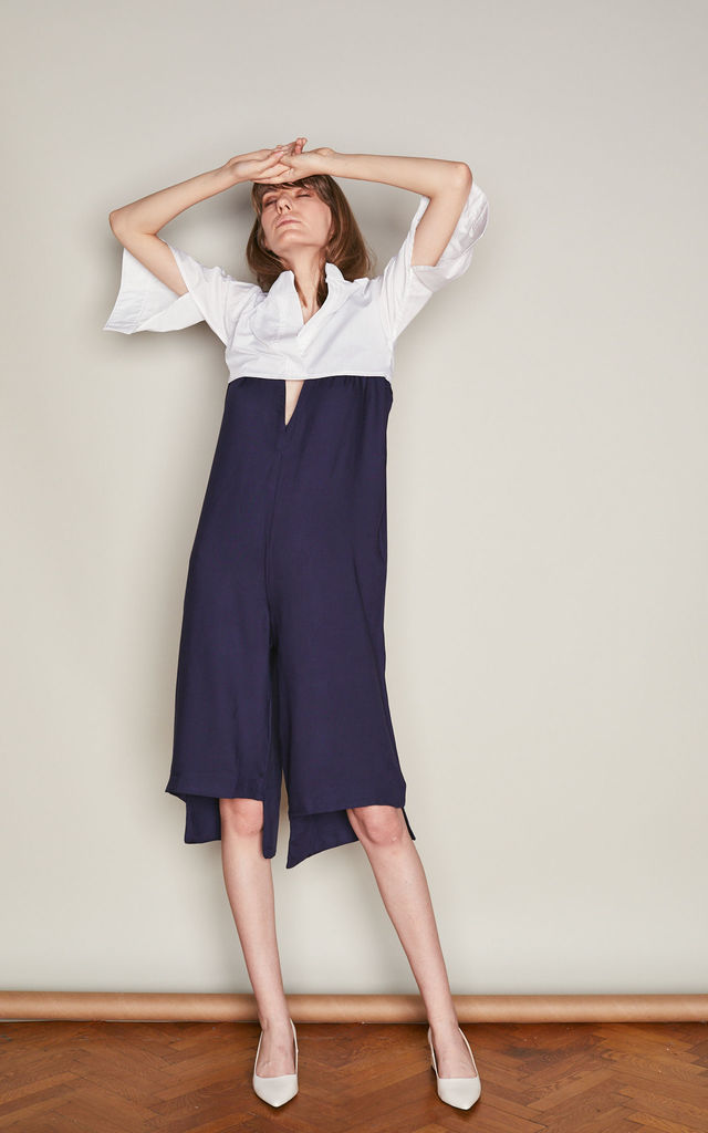 Navy Mullet Jumpsuit with Plunging Neckline by ACURRATOR