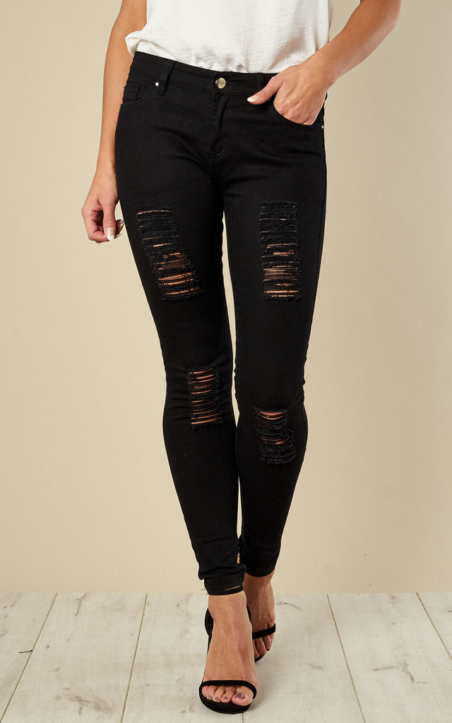 Ripped Skinny Jeans by Madam Rage