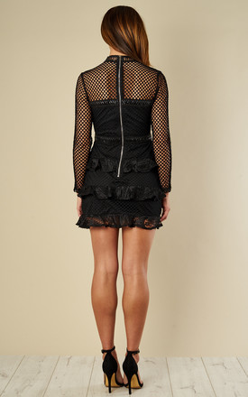 Black fishnet long sleeved frilled skirt mini dress by Glamorous