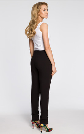Black chino trousers with draped waistband and front slant pockets by MOE