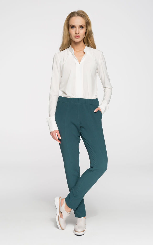 Green slim leg creased trousers by MOE