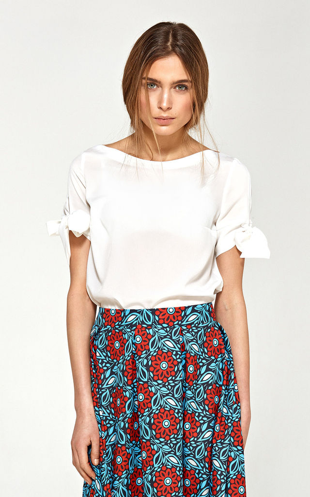 Bow sleeve top in white by so.Nife