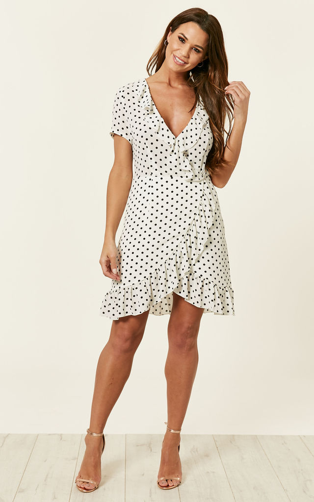 c10aae4438 White short sleeve frill wrap dress with black dots by Lilah Rose