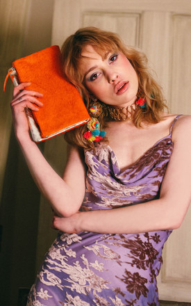 ORANGE FOLDED CLUTCH BAG by Luna Love London